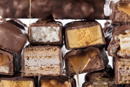 bounty: Close-up bunch of chocolate bars isolated over the white background