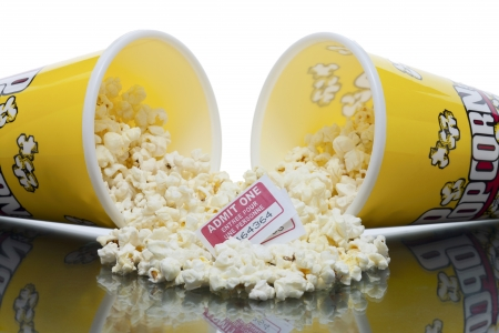 Close up image of two pop corn box fell into glass table with movie tickets on the center Stock Photo - 16957657