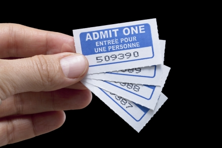 Close up image of four movie tickets against white background