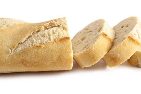 newly baked: Horizontal image of fresh slices of bread lying over the white background