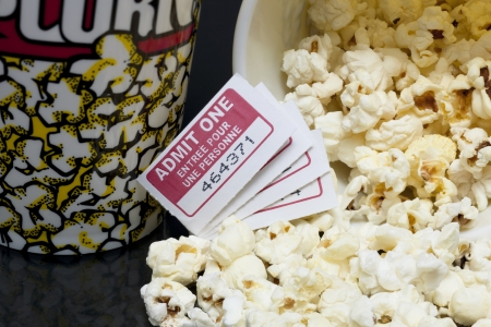 Scattered Movie pop corn with several tickets on a macro image Stock Photo - 16957778