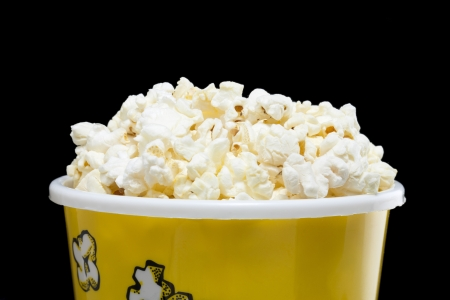 Macro image of a full pop corn box against dark background Stock Photo - 16956361