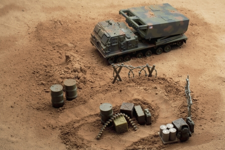 Image of military toy tracked vehicle on battle ground