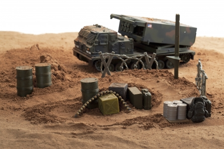Plastic Green Tracked Army Vehicle on a battlefield photo