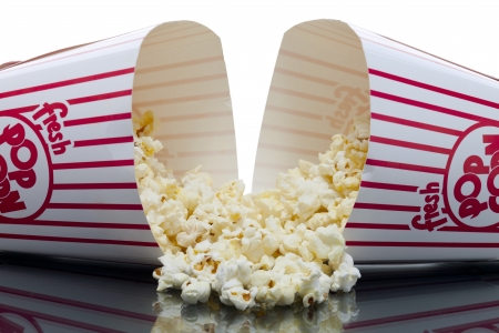 Close up image of pop corn spill from two popcorn bucket against white background Stock Photo - 16957701