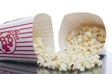 Close up image of scattered popcorn from bucket against white background Stock Photo - 16957575