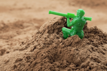bazooka: Horizontal image of soldier miniature holding a bazooka on a chocolate powder