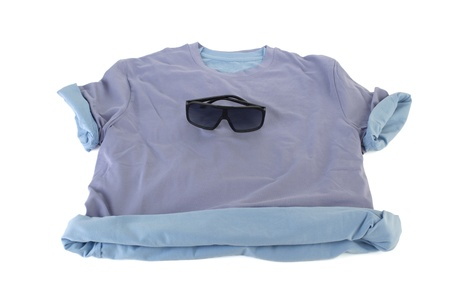 Sunglasses on t-shirt over white background Stock Photo - 16957558