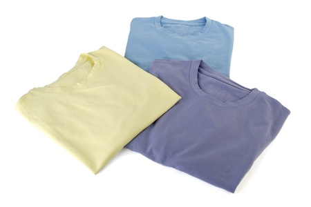 Close up image of three folded t-shirts against white background photo