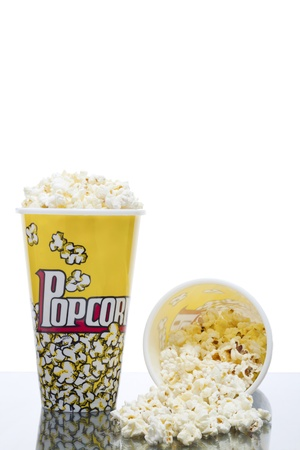Vertical image of two buckets of salted popcorn isolated over the white background Stock Photo - 16956278