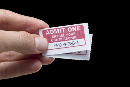 purchased: Close up image of two movie tickets against white background Stock Photo