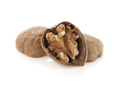 Close up image of cracked walnut against white background Stock Photo - 16963399