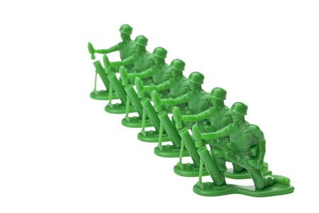 Plastic toy army isolated in a white background Stock Photo - 16963345