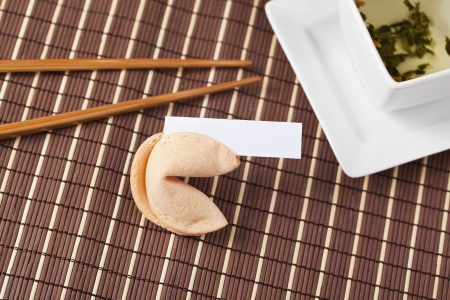 Cake fortune cookie with chopstick on a brown background Banco de Imagens