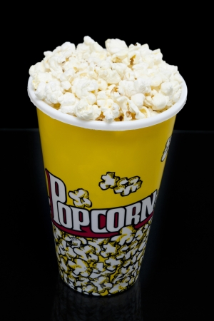 Popcorn bucket over the black background photo