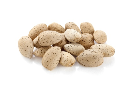 A heap of dried almond nuts over the white background Stock Photo - 16962942
