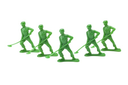 A group of action figures against white background Stock Photo - 16963842