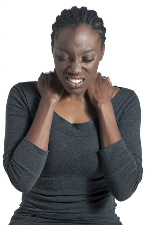 body pain: Portrait of an African-American woman with body pain over the white surface