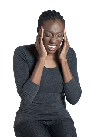 Close-up image of an African-American woman with headache over the white surface photo