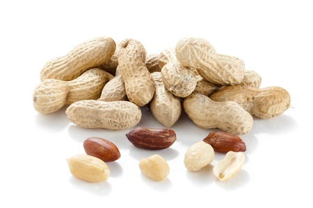 monkey nuts: Horizontal image of a pile of fresh ground nuts isolated on a white background Stock Photo