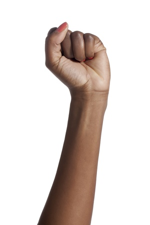 Close-up image of a woman's hand with a clenched fist over the white background Stock Photo - 16963148