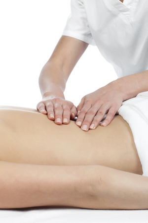 Masseuse giving a lower back massage on a woman Stock Photo - 16962186