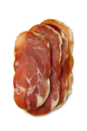 smoked bacon: Smoked bacon slices over a white background