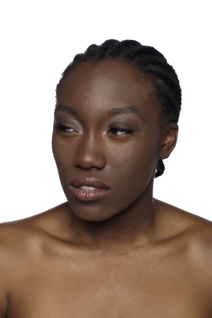 Portrait of black woman gesturing a suspicious look against white background photo