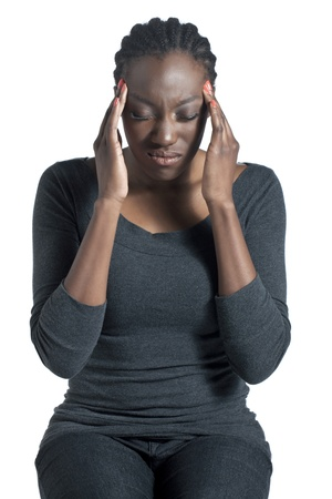 Portrait of black woman having headache against white background photo