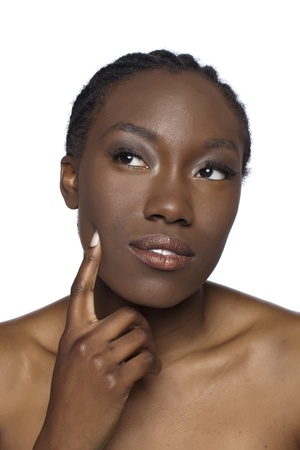 Portrait of black woman in thinking gesture against white background photo