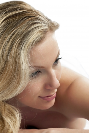 Close-up image of a blonde lady relaxing on the spa looking away photo