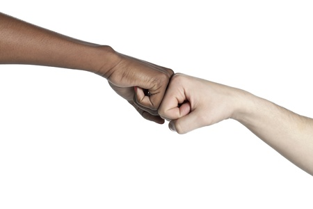 bump: Black and white female bumping their fists to show unity