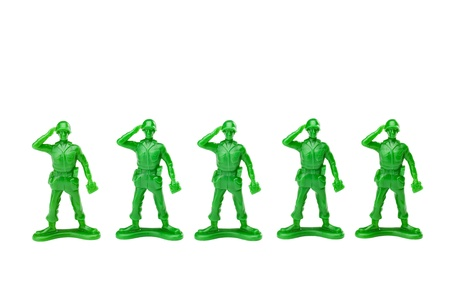 green plastic soldiers: A close up image of green toy soldiers against white background