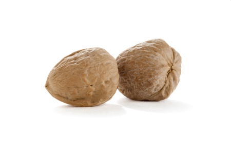 Close up image of walnuts against white background