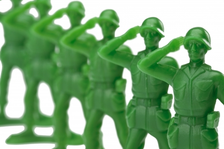 Close up image of a green military miniatures on a salute gestures against white background Stock Photo - 16963001