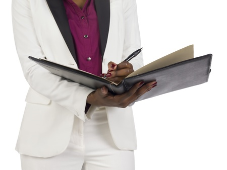 Close up of businesswoman holding files against white background Stock Photo - 16963154