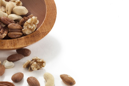 Cropped bowl of assorted nuts over a white background Stock Photo - 16963486