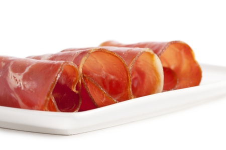 Delicious sliced ham on a white tray photo