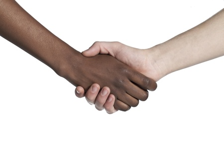 Black and white human hands doing a hand shake to show their friendship Stock Photo - 16963484