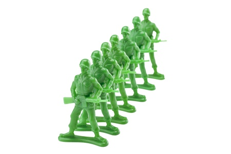 green plastic soldiers: Queue of green plastic toy soldiers isolated in a white background Stock Photo