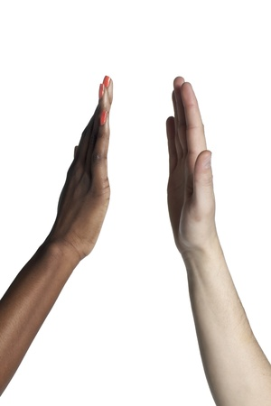 high up: Close-up image of human hands doing high five over the white background Stock Photo
