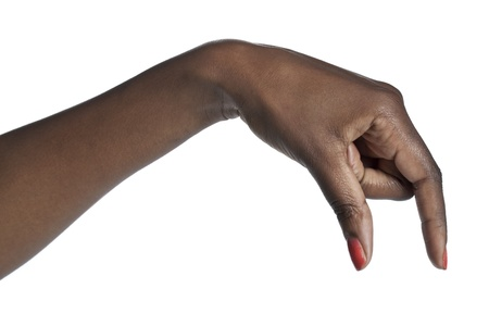 Close-up image of a human hand picking something over the white surface Stock Photo - 16963156