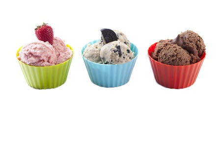 Bowl of ice creams in strawberry, cookies and cream and chocolate flavor isolated in a white background