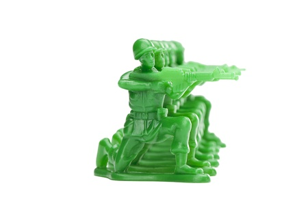 Horizontal image of a kneeling army miniatures against white background Stock Photo - 16962202