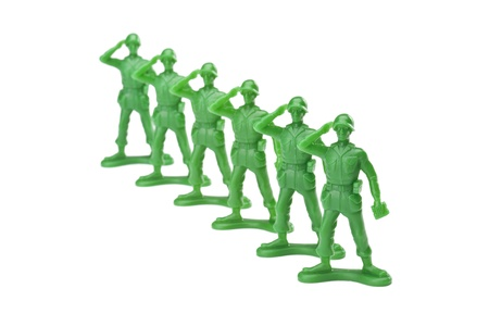 green military miniature: Horizontal image of group of military soldiers on a salute gesture Stock Photo