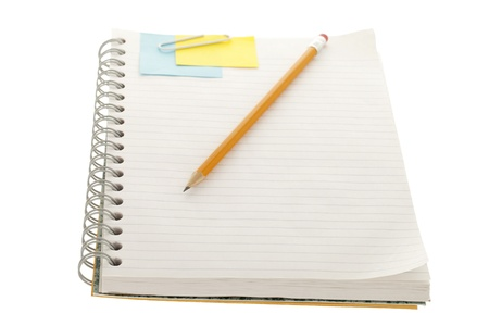 Notebook with adhesive note, paper clip and pencil in a close-up image photo