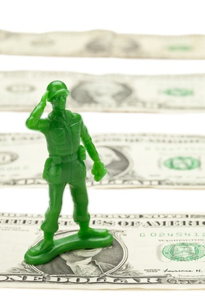 A row of one dollar bills with military toy photo