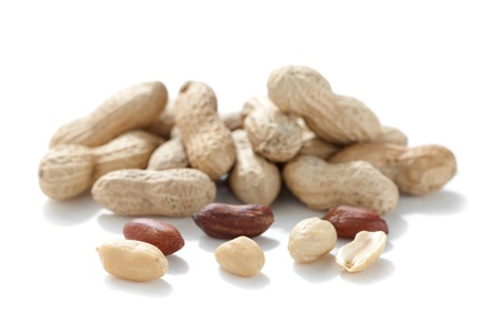 Pile of peanuts with shell and nuts isolated in a white background Stock Photo - 16963380