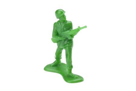 One plastic soldier on a white background photo