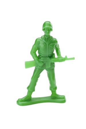 plastic soldier: Plastic toy soldier isolated in a white background